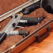 A paintball gun case made from an old violin case.